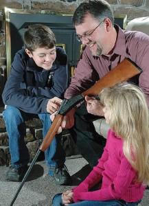 Dad teaching his kids about gun safety